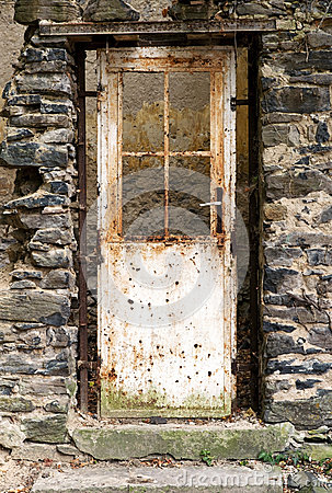 Old door in old ruin