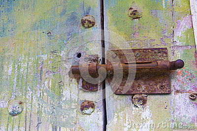 Old door with rusty latch.