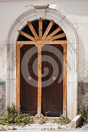 Old door shored up with wooden rods