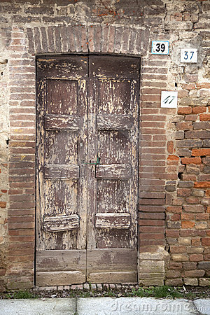 Old door with three different house numbers.