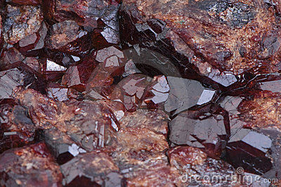 Old druse of crystals garnet stone