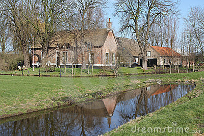 Old Dutch farmhouse in the meadow