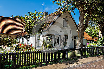 Old dutch house in hollum ameland holland stock photo for Classic dutch house of 60m2