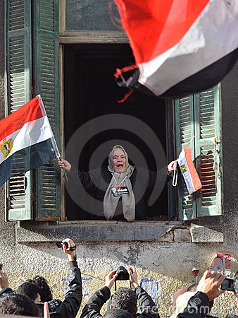 Old Egyptian woman supporting demonstrators Editorial Photo