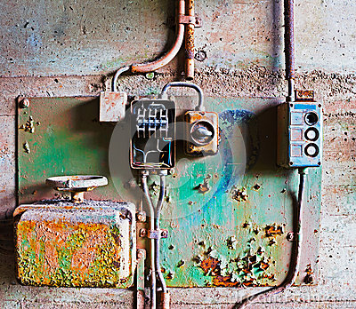 Old electrical panel on concrete wall