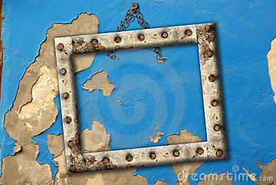 Old empty frame hanging on a broken wall blue