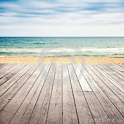 Free Old Empty Wooden Pier Perspective On Sandy Beach Royalty Free Stock Image - 69236026