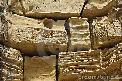 Old and eroded beige stones