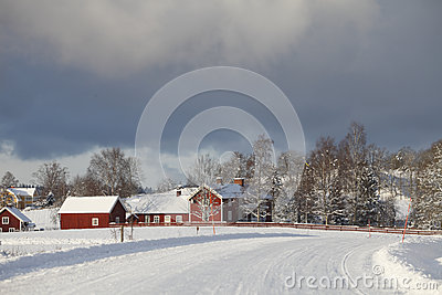 Old farm houses in a winter landscape
