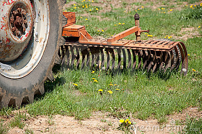 Old farm tractor plow