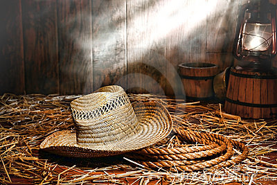Old Farmer Hat and Ranching Rope in Antique Barn