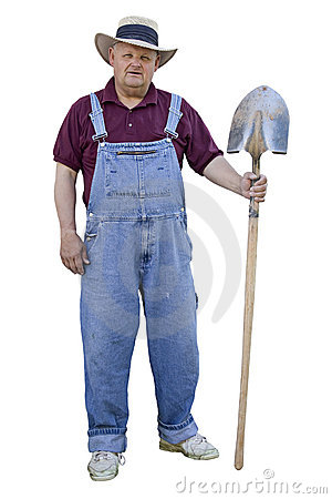 old farmer with denim overalls and a sun hat working. The farmer has ...