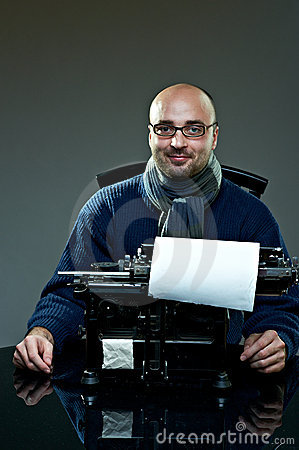 Old fashioned bald writer in glasses