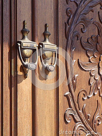 Old Fashioned Door Knocker With Carved Door Royalty Free