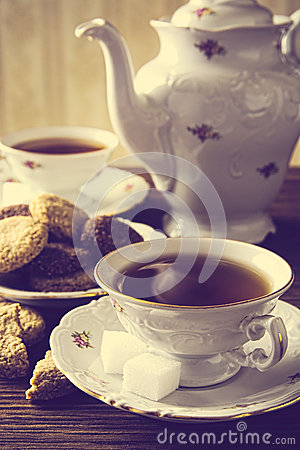 Free Old-fashioned Image With Two Cups Of Tea Vintage Effect With Cookies Stock Image - 52661581