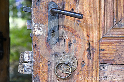 Old Fashioned Knocker On The Wooden Door Stock Photo