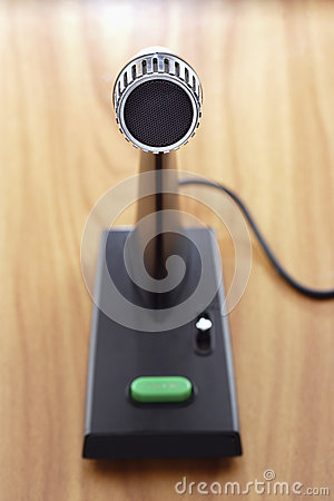 Old fashioned microphone on desk elevated view focus on foreground