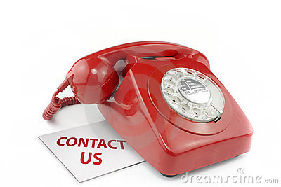 Old fashioned red telephone with contact us messag
