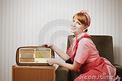 Retro house wife listening to the radio