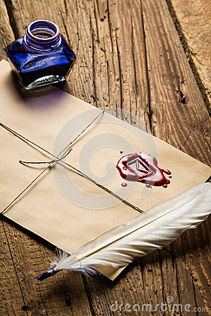 Old feather, envelope, sealing wax and ink bottle