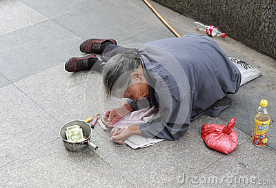 Old female beggar Editorial Stock Photo