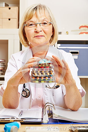 Free Old Female Doctor With Many Drugs Royalty Free Stock Images - 49745979