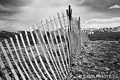 Old fence through mountains