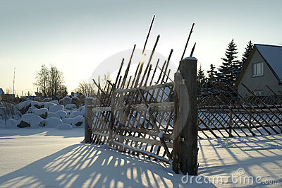 Old fence in snowy countryside