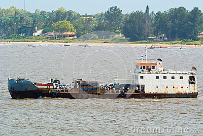 Old ferry with sub-tropical background