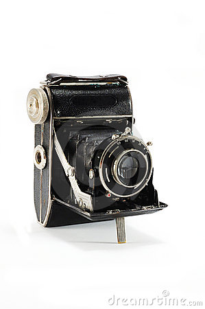 Old film photo camera on white background