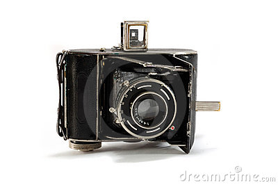 Old film photo camera on white background