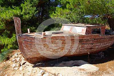 Old fishing boat on a rocky shore, Croatia