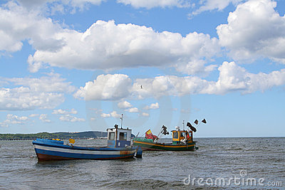 Old fishing boats against beautiful sky