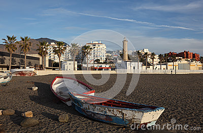 Old fishing boats on the beach in Estepona