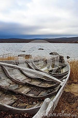 Old fishing boats on seashore