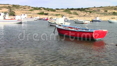 Old fishing boats. In small port of Koufonisia island, Cyclades islands, Greece stock footage