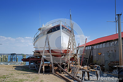 Old Fishing Trawler Being Restored In Old Boat Yard Royalty Free Stock ...