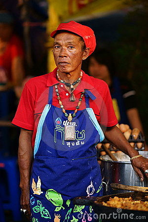 Old Food Vendor at Wat Saket compound. Editorial Stock Photo