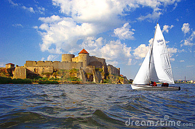 Old fortress and sailboat.