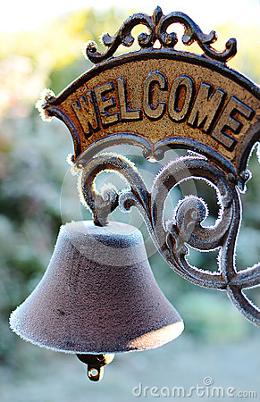Old frozen welcome sign
