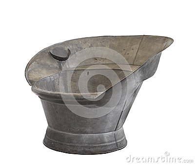Old galvanized tin sit-in bathing tub isolated.