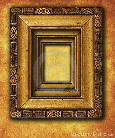 Old gold plated frame on grunge wall