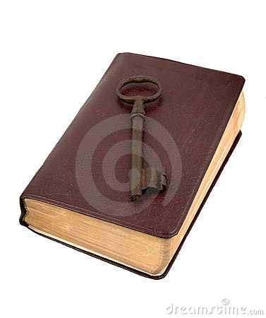 Old Golden Key On A Leather Book