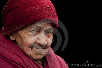 Old grandma in red headscarf with piercing look