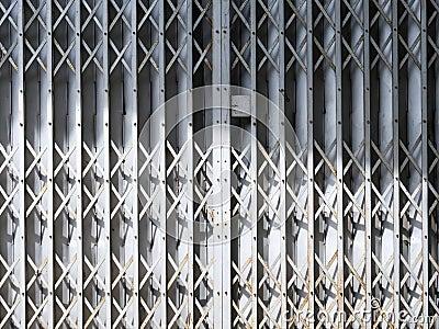 Old gray sliding metal door