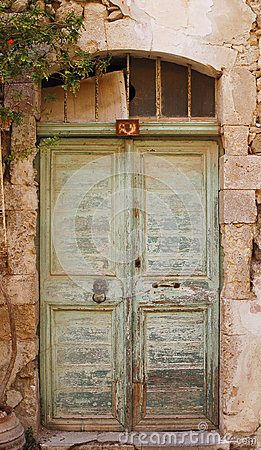 Old green door on Crete, Greece