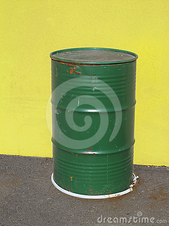 Old green metal barrel