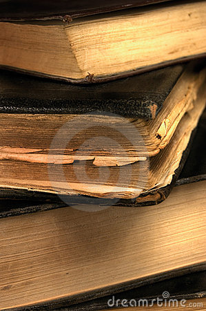 Old grungy books closeup in sepia shallow DOF