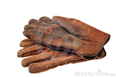 Old grungy work gloves isolated