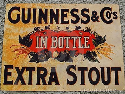 Old Guinness Sign Editorial Photography